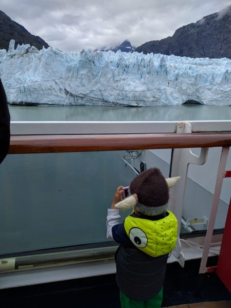 Tommy takes a picture of the glacier. Camera and wardrobe supplied by Mom.